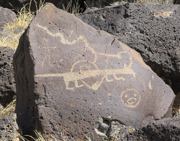 petroglyph of a coyote that looks dachshund-like